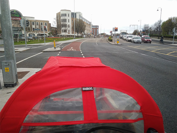 Cycling a cargo bike on a road in Dublin, Ireland